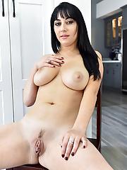 Allesandra MILF takes off her white bra and panties to pose nude