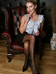 Astonishing MILF Georgie Lyall posing solo and spreading legs in stockings