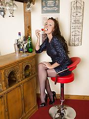 Beautiful brunette Marlyn slips out of her elegant dress