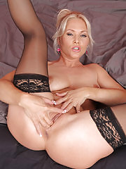 Beautiful Marlene stuffs her long fingers deep inside her