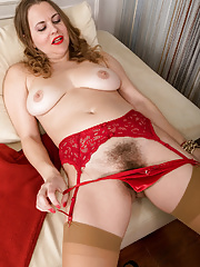 Beautiful mature Afeena disrobing and exposing her unshaven pussy