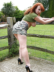Beautiful solo redhead strips naked and wide open pussy outdoors