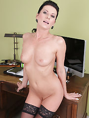Beautiful steno Olivia spreads her pussy wide on the desk