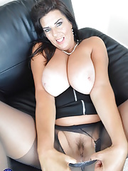 Big breasted amateur Lulu undresses her skirt and pantyhose