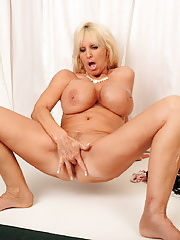 Big breasted blonde mature unveiling massive boobs