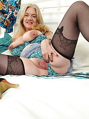 Big breasted Granny Lily May exposing big nipples in stockings