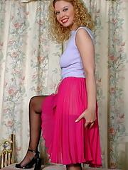 Blonde Emma in stockings showing her panties