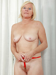 Blonde executive Sabine spreading her hairy pussy wide