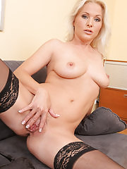 Blonde Marlene spreads her legs wide on her office chair