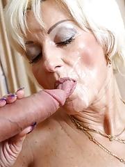 Blonde mature gets a bat in her cunt