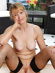Blonde mom removes her red dress and underwear before posing naked