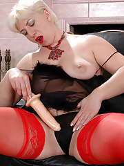 Blonde mommy warming up her snatch for a younger meat stick