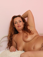 British mature lady undresses before toying her beaver