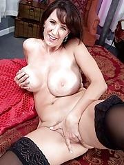 Brunette Cassie Cougar masturbating in stockings