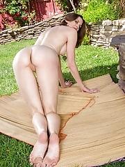 Brunette MILF Valerie Voxx rubbing her pussy outdoors