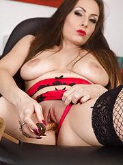 Brunette Sophie Delane slips a shiny toy into her moist box