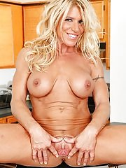 Busty blond cougar Gina West masturbating on the table
