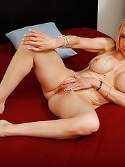 Busty blonde cougar Mirabella Amore pleasures her pussy
