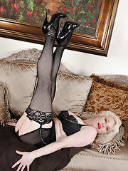 Busty blonde Goldie Rae in black lingerie and stockings