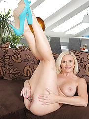 Busty blonde Lilly Peterson toying her tight pussy here