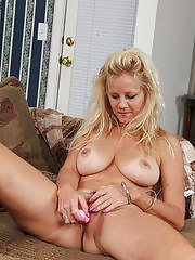 Busty blonde MILF Heidi Gallo toying her mature pussy on the couch