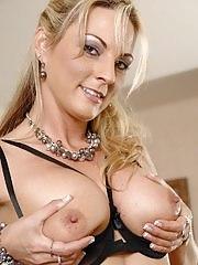 Busty blonde MILF Sindy Lange spreads her pink pussy lips