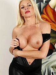 Busty cougar Casey Szilvia exposes shaved pussy