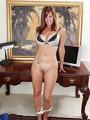 Busty cougar Karen Smith gets naked at the office