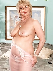 Busty granny showing her beauty body