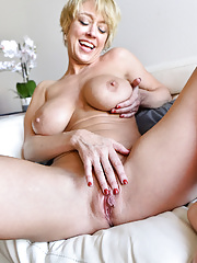 Busty Inked Blonde Milf Dee Williams exposing moist pussy and big ass in closeup