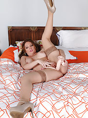 Busty Kiki D'Aire titty fucks a huge cock before riding it