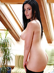 Busty milf beauty Alex Black strips and shoves a huge glass dildo deep in her shaved pussy