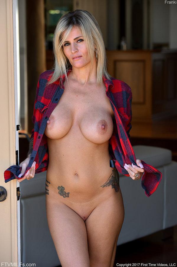 Blonde tattooed milf