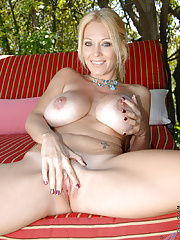 Busty milf gets naughty and undressing by the pool