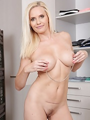 Busty milf housewife Lilly Peterson taking off her panties