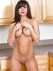 Busty MILF Mackenzie Marie strips naked in kitchen