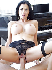 Busty MILF shows off her pussy in some crotchless panties