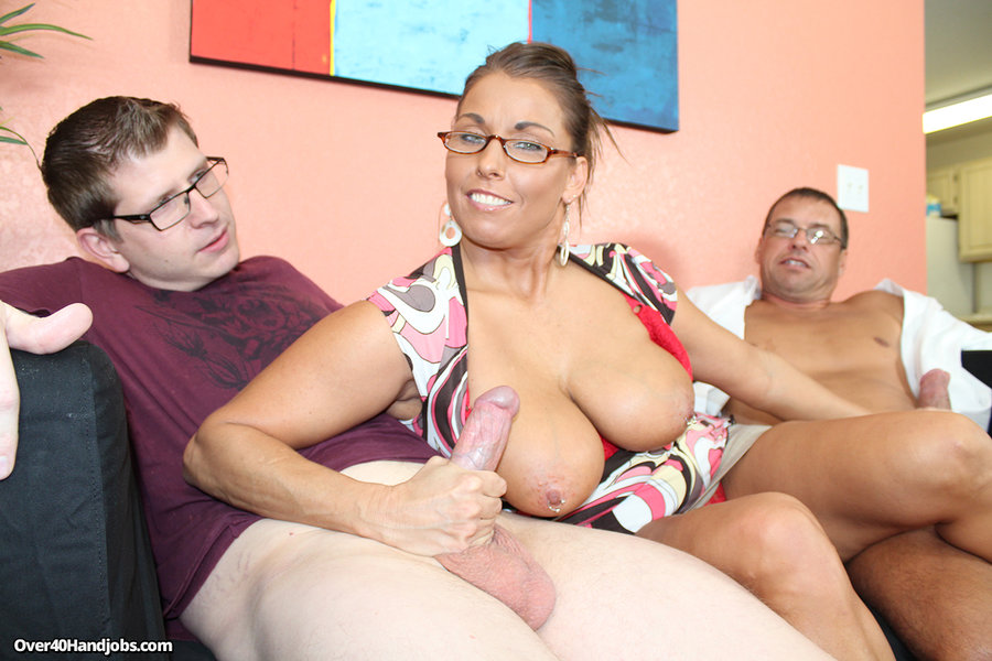 ... Busty milf Stacie jerking off her step son and her husband at the same  time ...