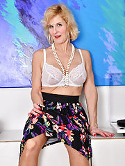 Busty Molly Maracas takes off her long skirt to show her stockings and panties