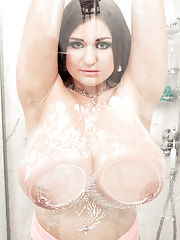 Busty mom uncovers her large boobs and wet bald pussy in the shower