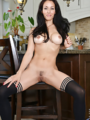 Busty mommy Olivia Bell in black dress and stockings strips