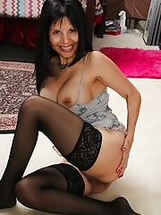 Busty older babe Marcy Darling spreads her pussy lips
