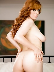 Busty redhead Penny Pax shows her big round tits
