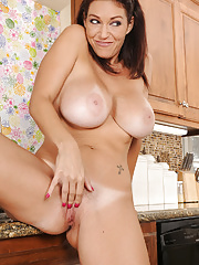 Charlee Chase gets her big titties wet in the kitchen