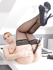 Charlotta Rose spreads her long legs on her office desk