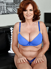 Chubby solo mature in blue lingerie opens up her pink pussy