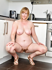 Cock hungry mom gets naked and finger fucks her hairy twat