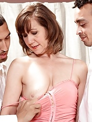 Cougar having fun with two cocks during MMF threesome