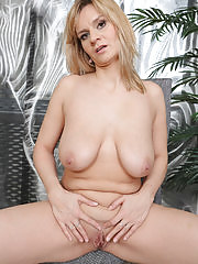 Cute blonde Charlotta Rose showing off her large mams