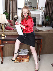 Cute blonde steno Amber Carlisle gets naked at the office